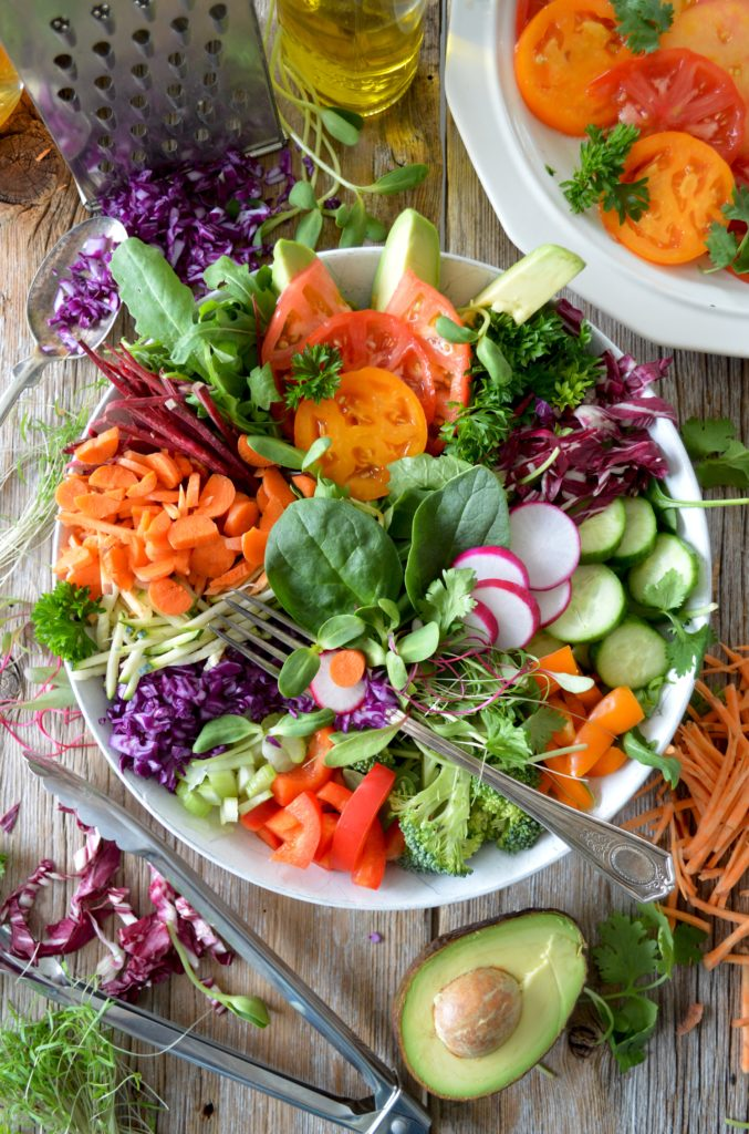 Home grown salad loaded with a variety of fruits and vegetables
